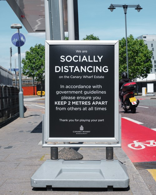 Social distancing sign in Canary Wharf